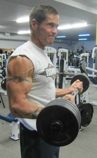 celebrating his 50th birthday with a ripped physique